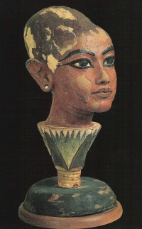 Head of young King Tutankhamun emerging from a lotus flower (Cairo Museum)